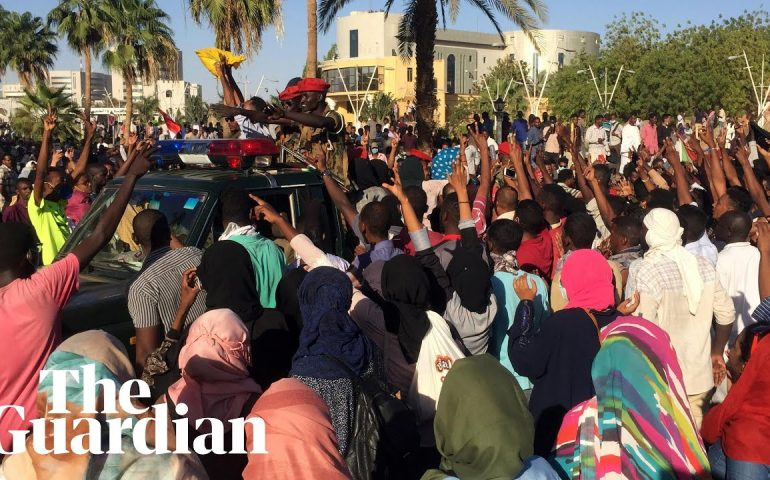 Thousands of Sudanese protesters gather outside presidential residence and military HQ
