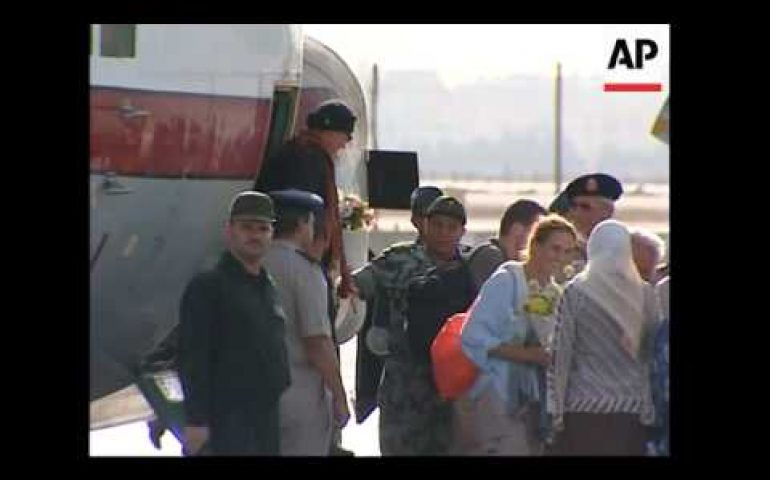 Freed hostages return, officials say no ransom paid
