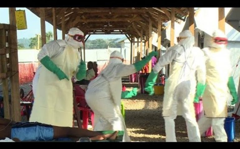 Health workers in Sierra Leone dance to cheer up Ebola patients